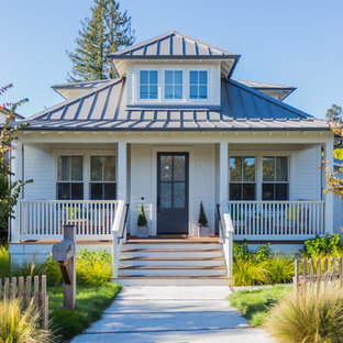 Elegant white one-story house exterior photo in San Francisco with a hip roof and a metal roof