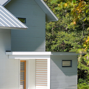 Cottage white two-story wood gable roof idea in Burlington