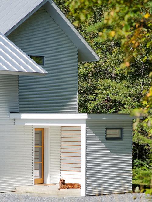 Farmhouse White Two Story Wood Gable Roof Idea In Burlington