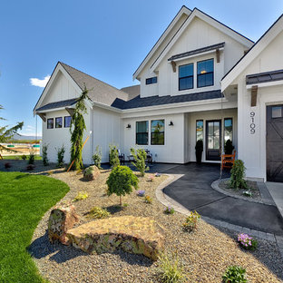 Example of a large farmhouse white two-story wood exterior home design in Boise