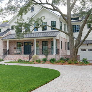 Inspiration for a large farmhouse white two-story mixed siding exterior home remodel in Houston with a shingle roof