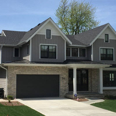 Mid-sized transitional gray two-story mixed siding exterior home photo in Chicago with a shingle roof