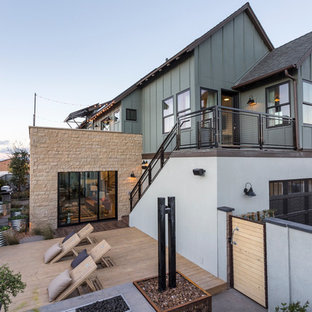 Transitional green two-story mixed siding gable roof idea in Los Angeles
