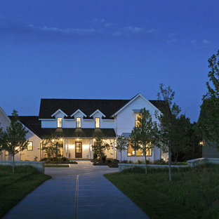 Farmhouse two-story exterior home photo in Omaha
