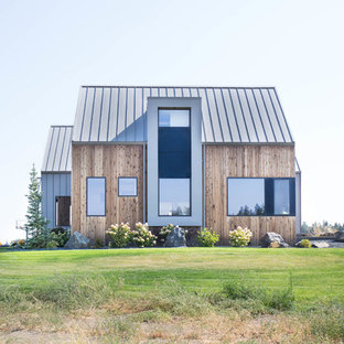 Large contemporary brown three-story wood exterior home idea in Other with a metal roof