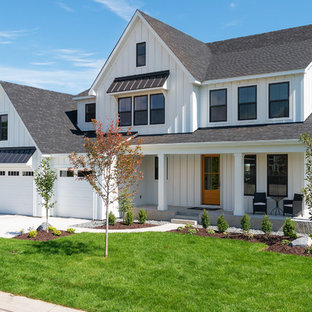 Large country white two-story wood gable roof idea in Minneapolis with a shingle roof