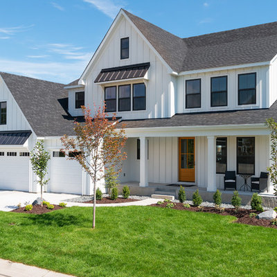 Large country white two-story wood exterior home idea in Minneapolis with a shingle roof