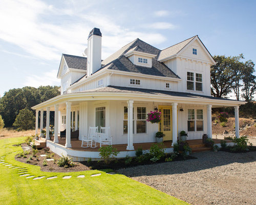 example of a mid sized country white two story exterior home design in portland - Hip Home Design Sites
