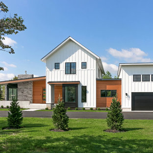 Mid-sized cottage white two-story mixed siding house exterior idea in Philadelphia with a shed roof and a shingle roof