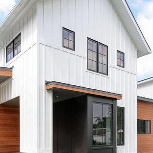 Mid-sized country white two-story mixed siding house exterior idea in Philadelphia with a shed roof and a shingle roof