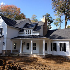 Farmhouse Exterior by Rembrandt Homes Inc.