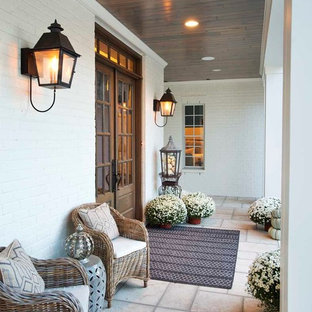 Inspiration for a large country white two-story brick exterior home remodel in Nashville