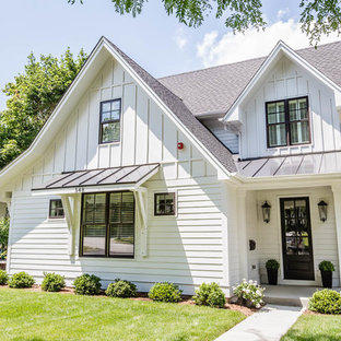 Inspiration for a mid-sized farmhouse white two-story wood exterior home remodel in Chicago with a shingle roof