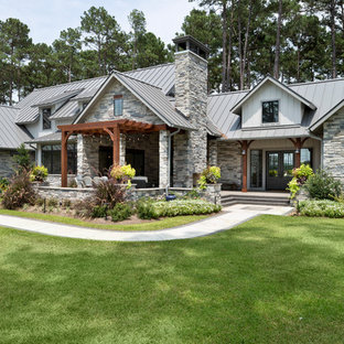 Mid-sized cottage gray one-story mixed siding exterior home idea in Houston with a metal roof