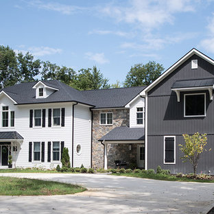 Example of a large country gray two-story mixed siding house exterior design in Indianapolis with a hip roof and a shingle roof
