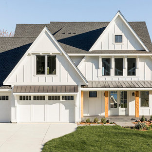 Example of a farmhouse white two-story exterior home design in Minneapolis with a shingle roof