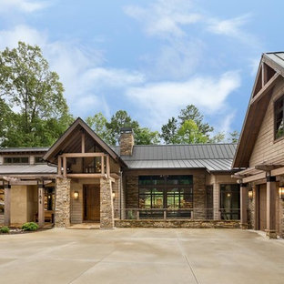 Example of a large mountain style brown two-story mixed siding gable roof design in Atlanta