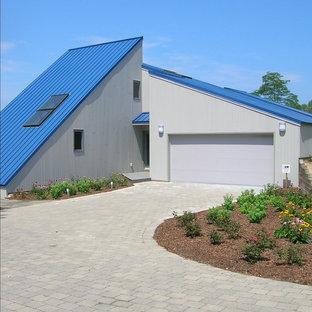 Kleines, Blaues Modernes Haus mit Pultdach in Grand Rapids