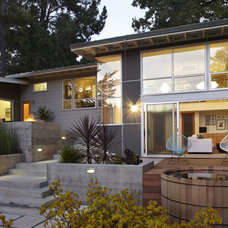 Midcentury Exterior by Allwood Construction Inc