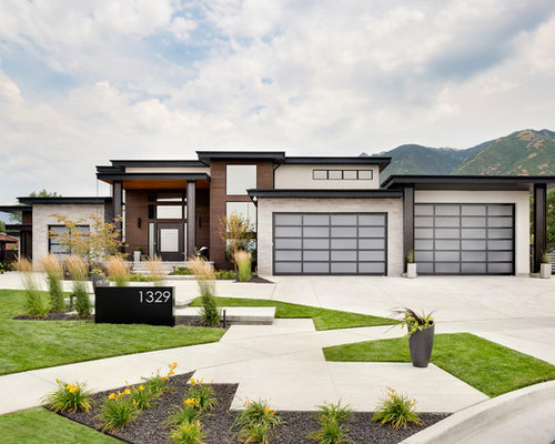 Example Of A Trendy One Story Mixed Siding Flat Roof Design In Salt Lake  City