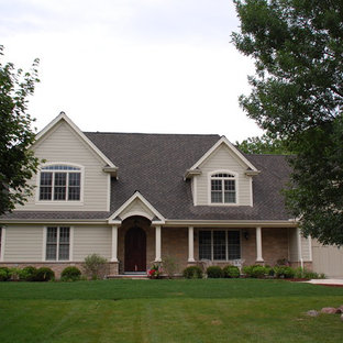 Example of a mid-sized minimalist beige two-story concrete fiberboard exterior home design in Other with a shingle roof