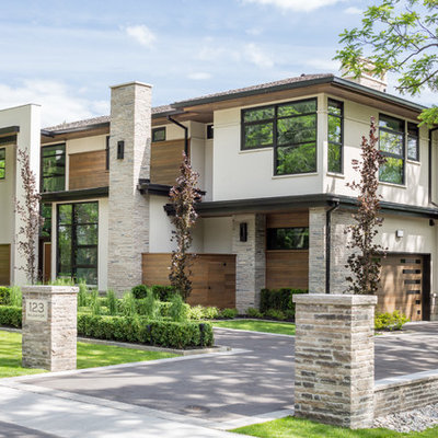 Inspiration for a large contemporary brown two-story wood exterior home remodel in Toronto