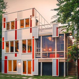 Idee per la facciata di un appartamento grande grigio moderno a tre piani con rivestimenti misti e tetto piano