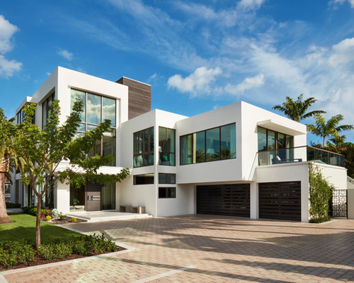 Example Of A Minimalist White Two Story Flat Roof Design In Miami