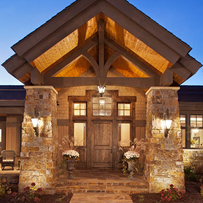 Inspiration for a huge rustic beige two-story mixed siding house exterior remodel in Minneapolis