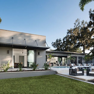 Large minimalist gray one-story concrete flat roof photo in Orlando