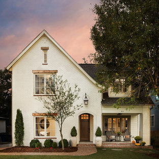 Mid-sized elegant white two-story brick exterior home photo in Birmingham