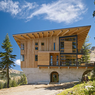 Example of a huge mountain style three-story wood exterior home design in San Francisco with a shed roof