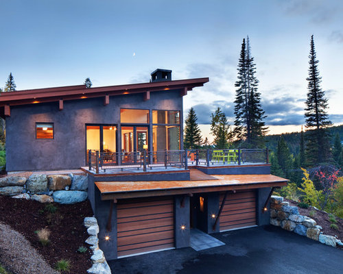 Example Of A Huge Mountain Style Brown Two Story Stucco Exterior Home Design  In Denver