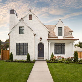 Elegant white two-story exterior home photo in Salt Lake City with a shingle roof