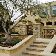 Mediterranean Exterior by The Design Build Company