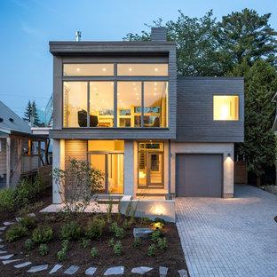 Идея дизайна: двухэтажный, большой фасад дома серого цвета в современном стиле с плоской крышей и комбинированной облицовкой