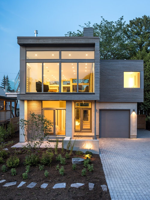 Example Of A Large Trendy Gray Two Story Mixed Siding Flat Roof Design In Ottawa