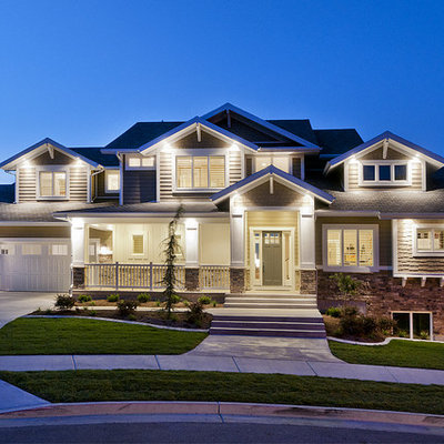 Inspiration for a large craftsman beige two-story concrete fiberboard exterior home remodel in Salt Lake City