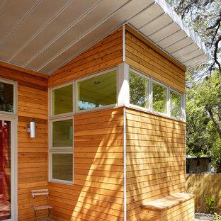 Minimalist wood exterior home photo in Austin