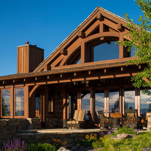 Photo of a brown and large rustic two floor detached house in Kansas City with wood cladding and a pitched roof.