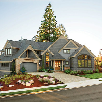 Elegant wood exterior home photo in Cleveland