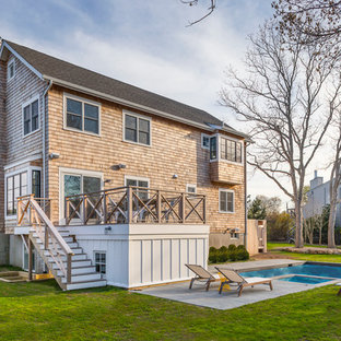 Mid-sized coastal brown three-story wood gable roof photo in New York