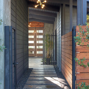 Midcentury modern gray two-story concrete exterior home photo in San Francisco