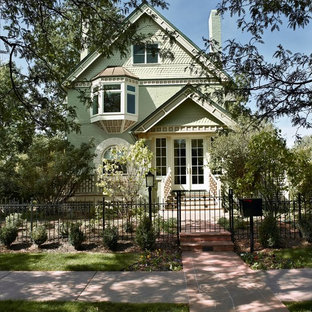 Inspiration for a green victorian two floor exterior in Denver.