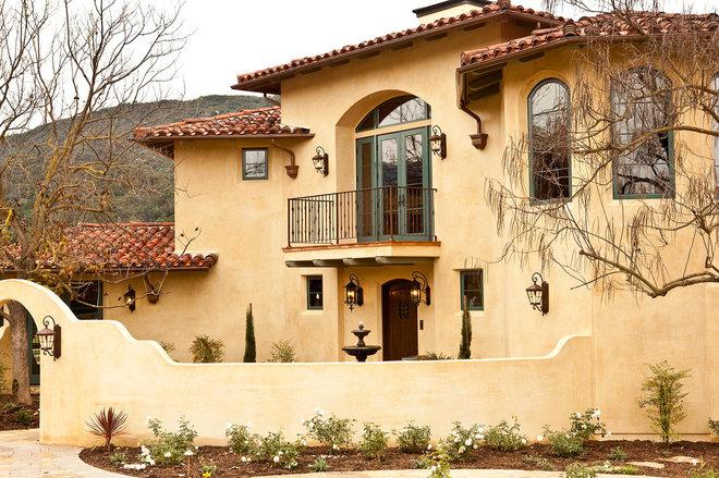 Mediterranean Exterior by Whitman Design Build Inc.