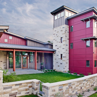 Inspiration for a large contemporary three-storey red house exterior in Austin with mixed siding, a shed roof and a metal roof.