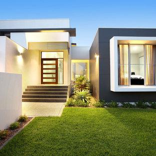 Idee per la facciata di una casa contemporanea a un piano di medie dimensioni con tetto piano