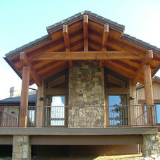 Eclectic Exterior by Capistrano Homes and Landscaping, LLC.