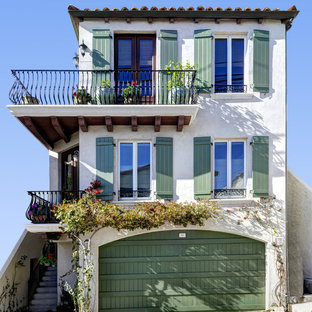 Inspiration for a mid-sized mediterranean two-story exterior home remodel in Los Angeles