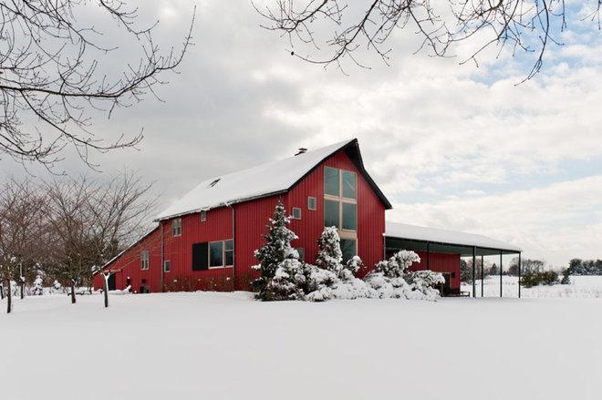 Farmhouse Exterior by Sandvold Blanda Architecture + Interiors LLC
